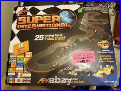 AFX Super International 4 lane track with cars