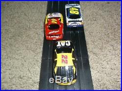 Life like slot car track nascar # 48 lowes, # 44 kelloggs, # 22 cat, ho scale